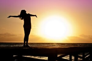 sunset-woman-with-arms-up