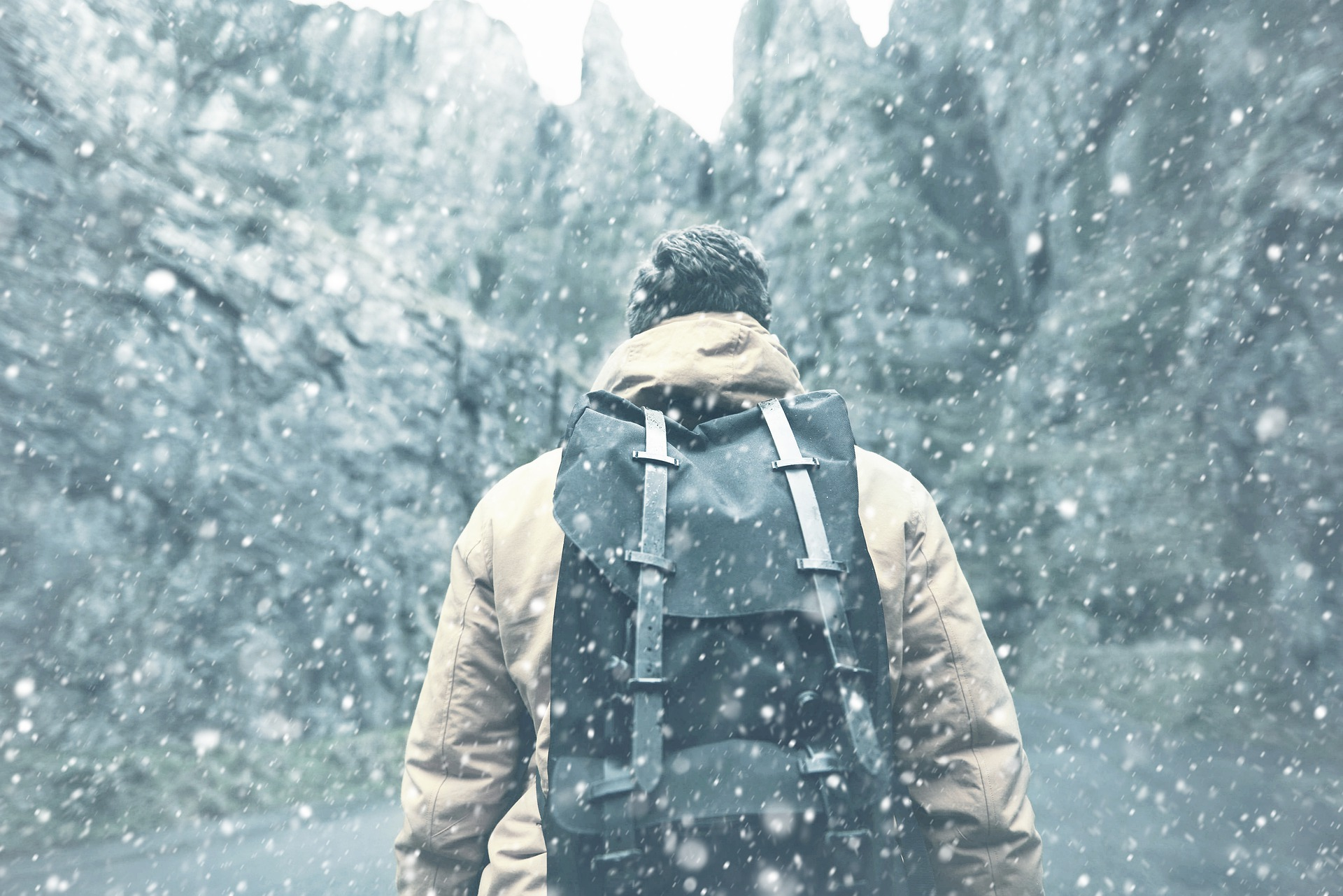 Man-in-snow-with-backpack